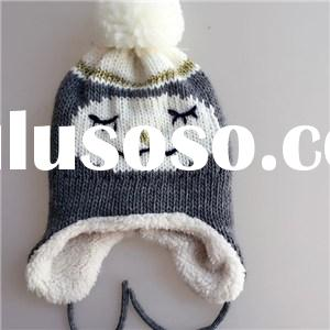 Quality Acrylic contrast color jacquard knitted kid earcuff hat with pom and embroidered