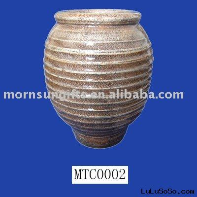 rimmed terracotta antique pot