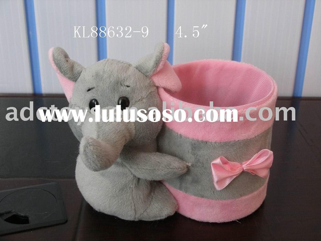 lovely elephant with a pen container