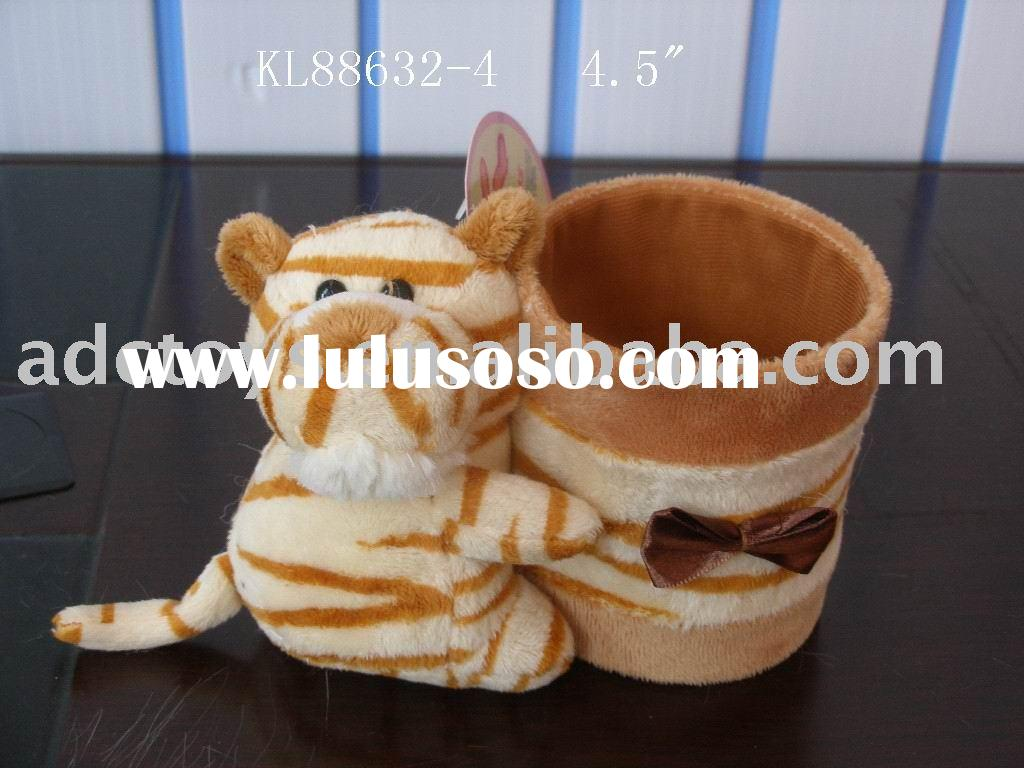 lovely tiger with a pen container