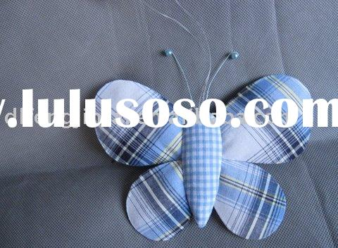 Textile butterfly with tartan design