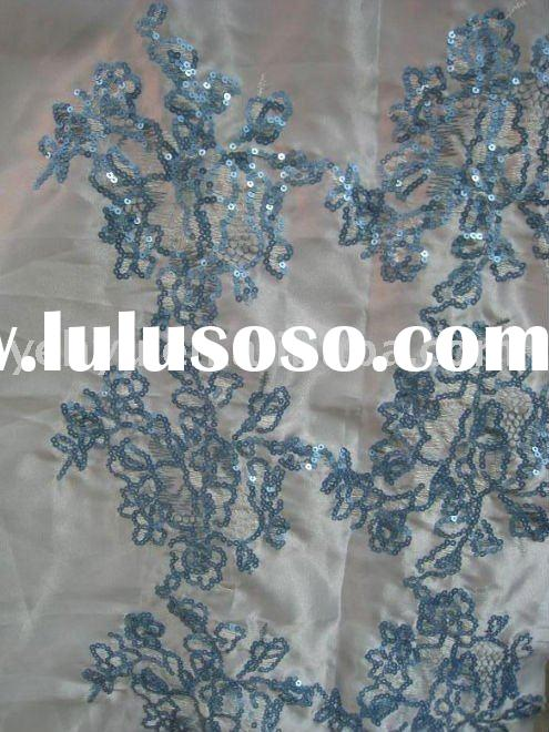 white satin embroidered fabric with blue sequin embroidery decoration