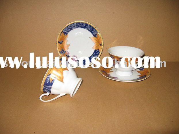 porcelain cup and sauser with maple leaf design