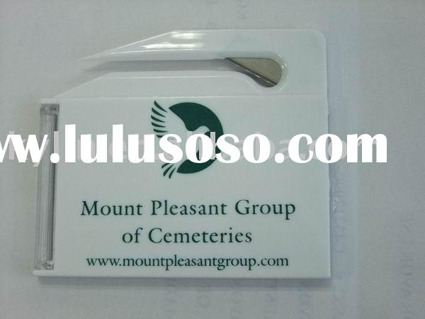 letter opener with business card holder  and cosmetic mirror