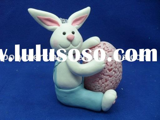 pretty white rabbit craft/ornament carrying an egg made of clay is widely used on Easter as a gift f