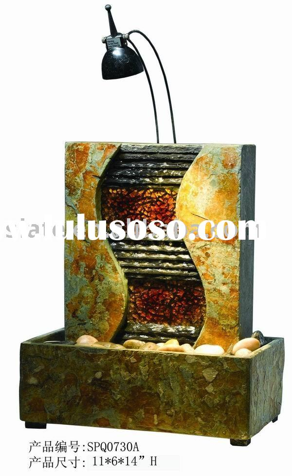 rusty slate table water fountain with light