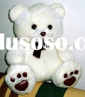 Plush and stuffed white teddy bear
