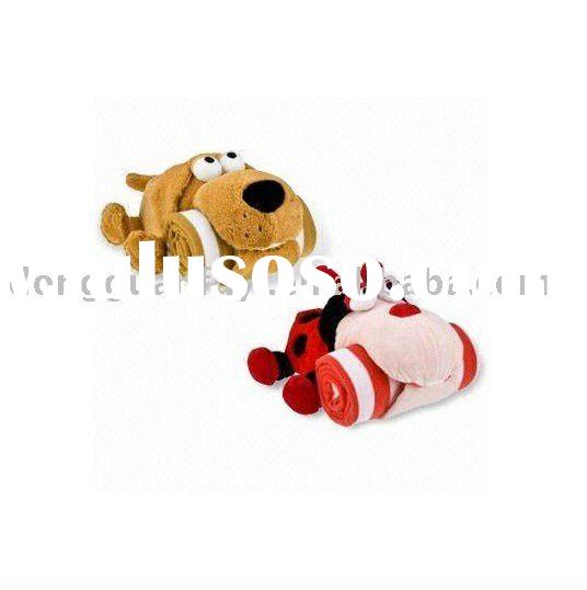 Stuffed plush dog toy with blanket in mouth