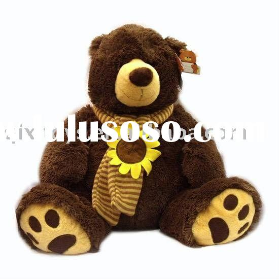 big stuffed plush teddy bear with sunflower scarf