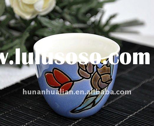 Reactive glazed ceramic cup and saucer set, blue color