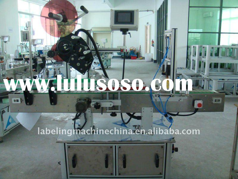Improved type high speed top labeling machine