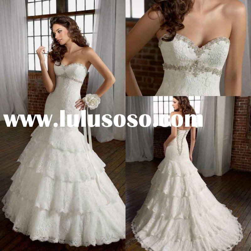 Fashion strapless mermaid appliqued cascading ruffle wedding dress