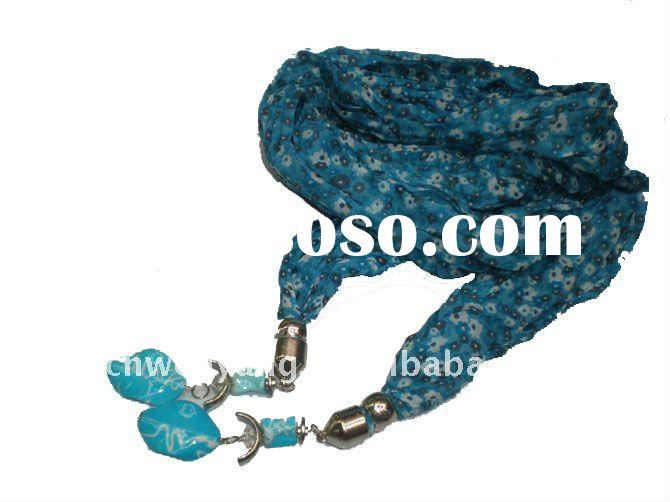 Fashion scarf with jewelry pendant