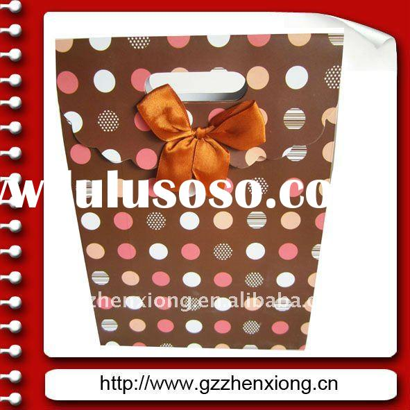 Gift paper candy handbag with fabric strip