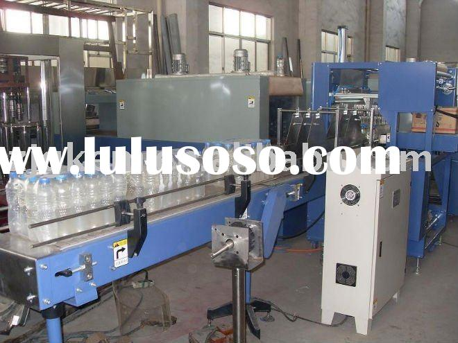 Automatic bottle heat shrink wrapping machine