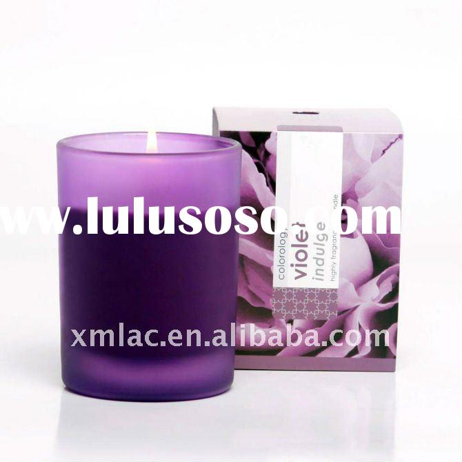 Color scented candle in glass jar