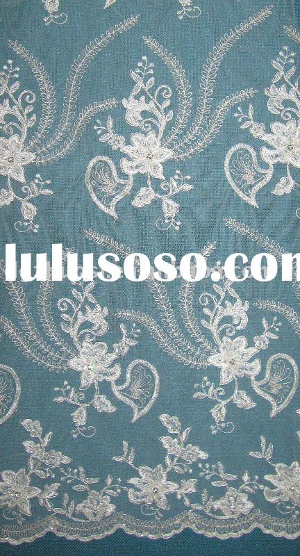 Ivory and white sequins embroidery fabric