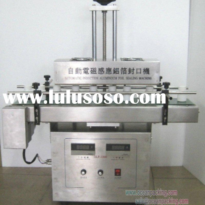 small scale automatic plastic food containers sealing machine