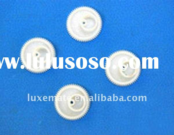 small plastic toy gears