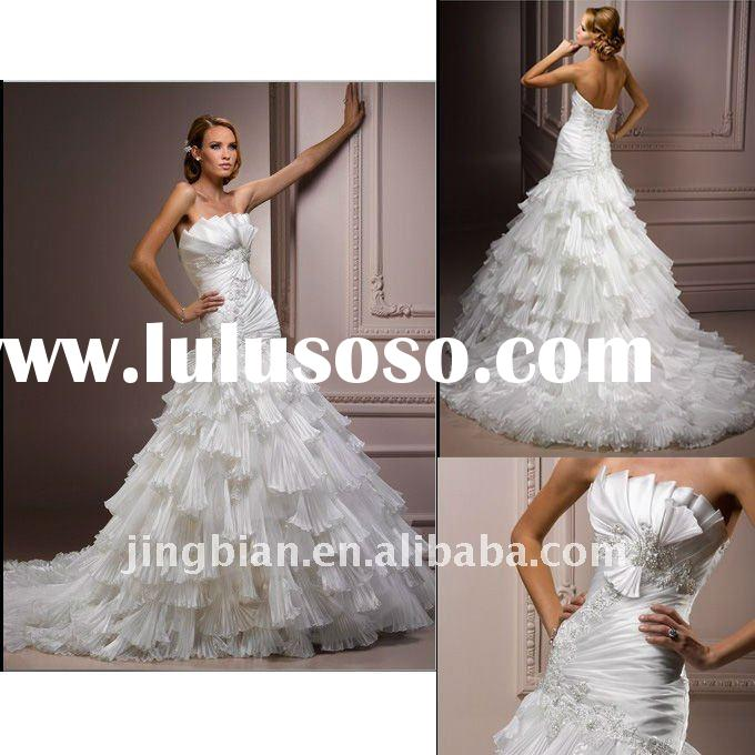Drama takes center stage Wedding Dress with origami inspired pleated bodice and pleated ruffle skirt