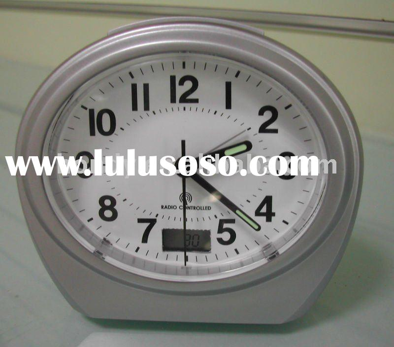 Radio controlled alarm clock with LCD