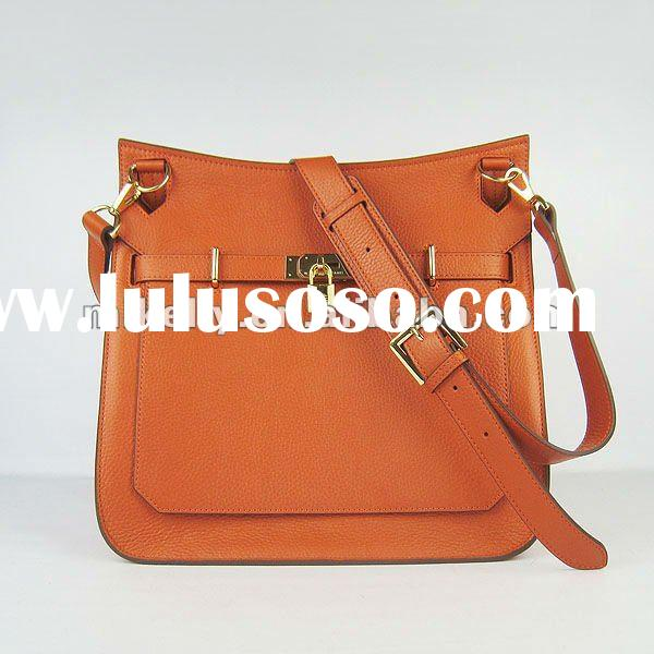 designer Orange leather shoulder bag.cross body bag long strap