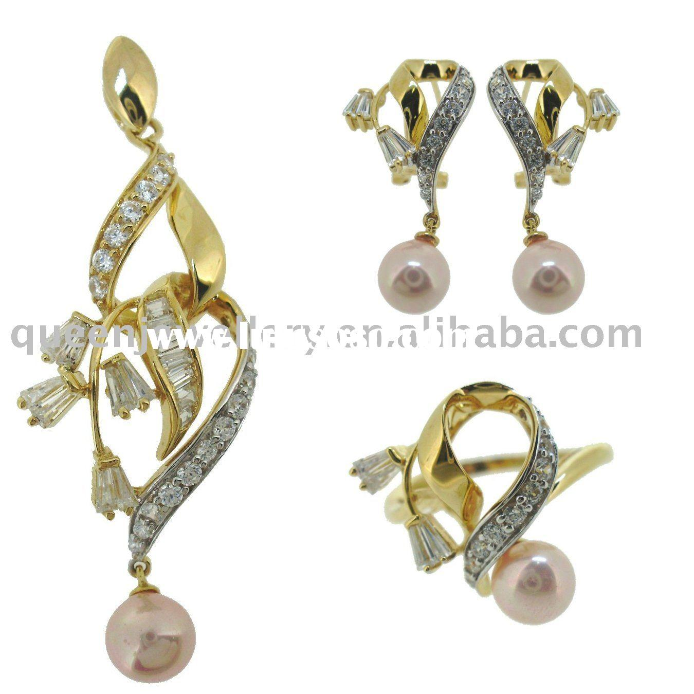 18k gold jewelry set with white cz and pearl
