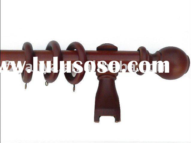 Golden Wooden Curtain Rod of Window