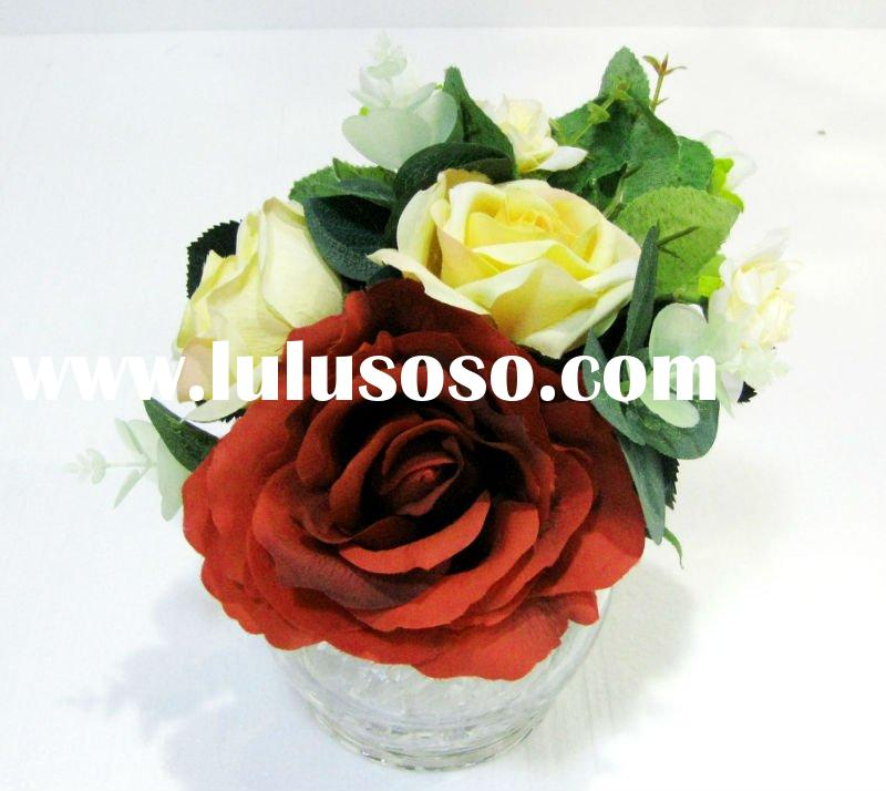 small artificial flower with vase