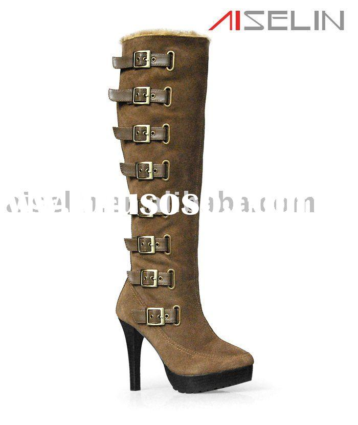 High heel leather boots with fur and buckles