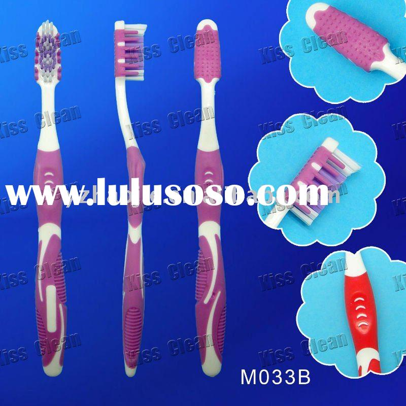 Adult Toothbrush with gum massager and tongue cleaner