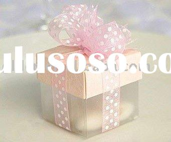 small delicate gift packing box with colorful ribbon