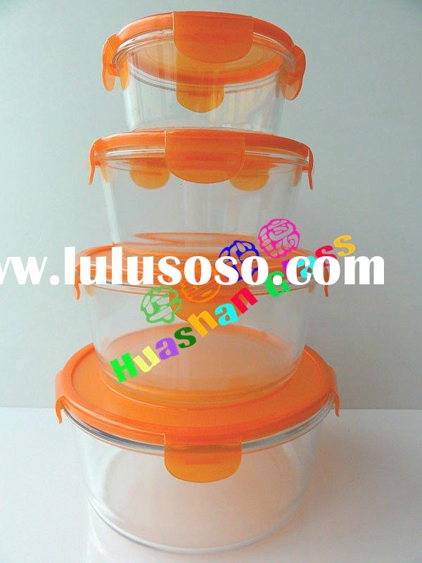 Round pyrex glass food container with orange color lid