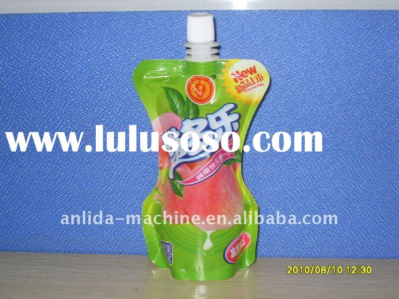 Spout pouch filling sealing packing machine
