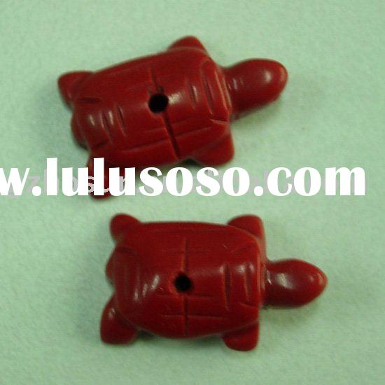 carved small animals turtles in imitation red coral