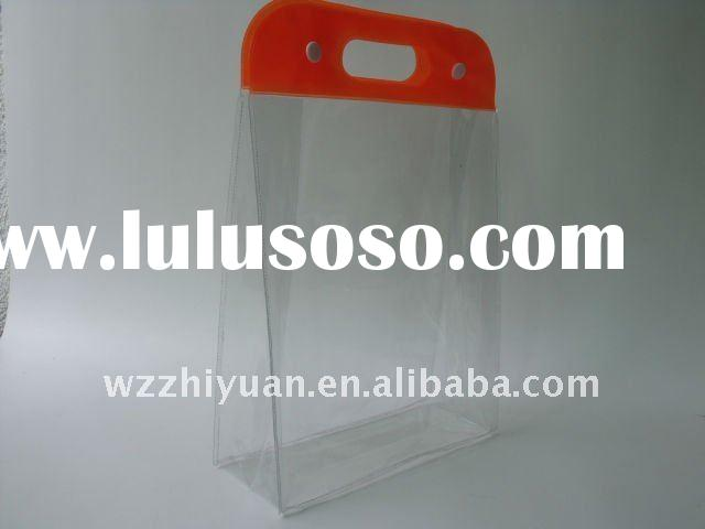 Clear PVC Cosmetic Bag with Button Closure and Die Cutting Handle For Travelling