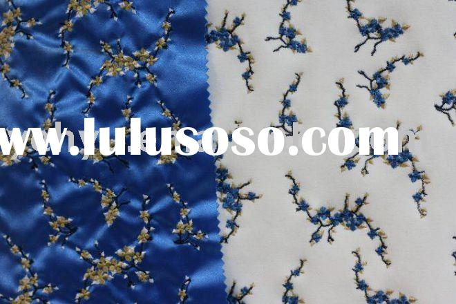 white and blue embroidery fabric with blue and white flower embroidery design