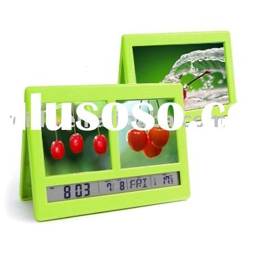 Digital alarm clock with photo frame and clip