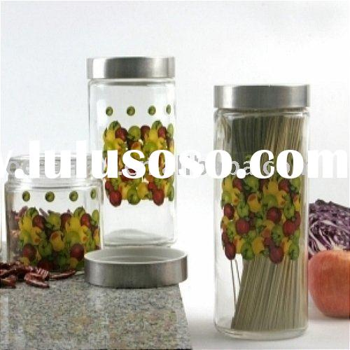 Hand decorated glass storage jar with metal lid