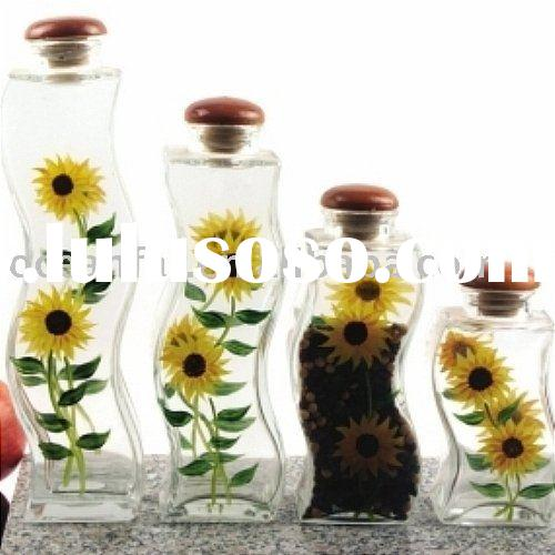 Hand painted clear glass storage jar with wood lid