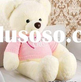 Plush white teddy bear with pink clothes