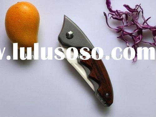 Ceramic folding knives with wood&alloy handle