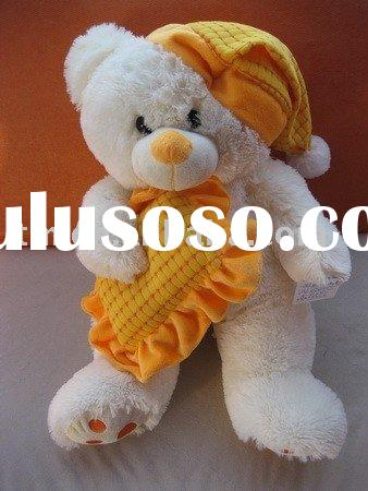 Plush white teddy bear with pajamas