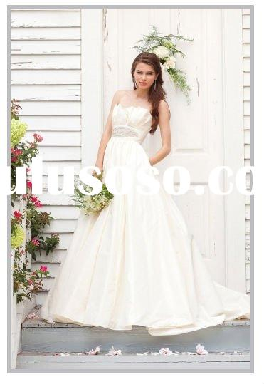 Slik taffeta strapless ball gown with pockets with crumb neckline and beaded motif bridal gown