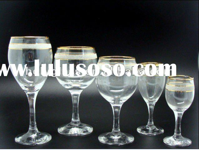 clear wine glass with gold and forsted decoration on the top