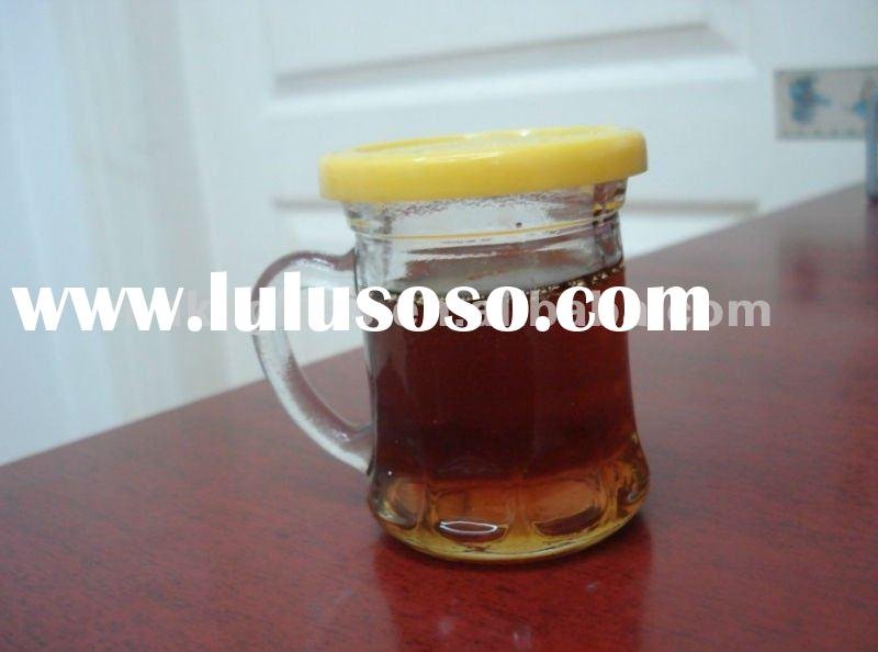 small round glass storage jar for honey with plastic cover