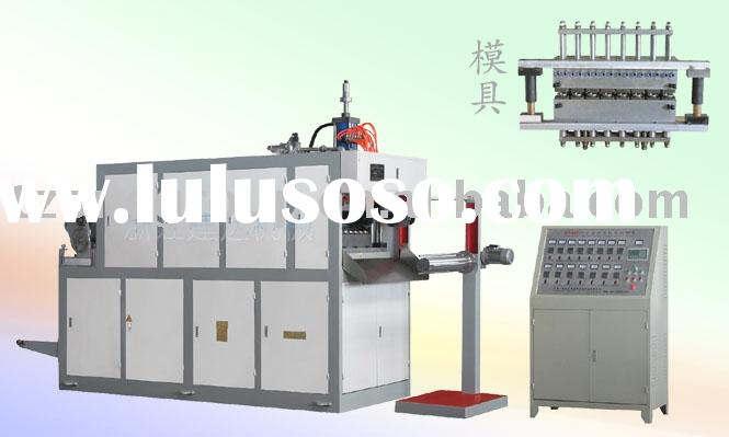 Plastic cup forming machine