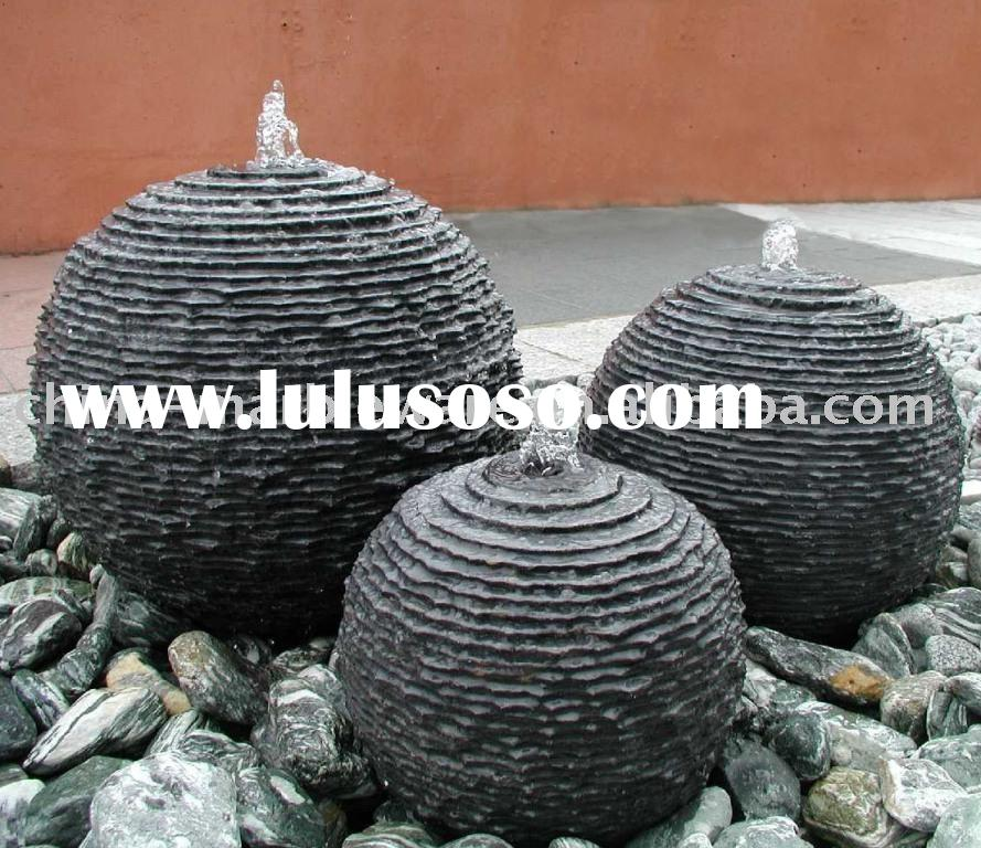 black ball fountain with small ladder