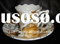 white ceramic coffee cup and saucer with decal