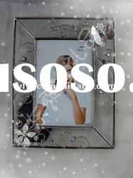 Glass photo frame with metal ornament
